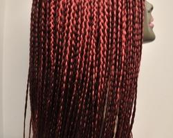 Lange pruik rood met vlecht